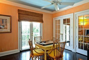 Traditional Dining Room with Hardwood floors, Crown molding, Ceiling fan, French doors