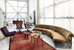 Modern Living Room with Verner Panton Pantonova modular sofa, Built-in bookshelf, High ceiling, Concrete floors