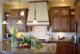 Traditional Kitchen with Stone Tile, Kitchen island, double wall oven, Custom hood, Simple granite counters, Limestone Tile
