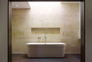 Contemporary Master Bathroom with Bathtub, Freestanding, Wall Tiles, Hardwood floors, can lights, Standard height