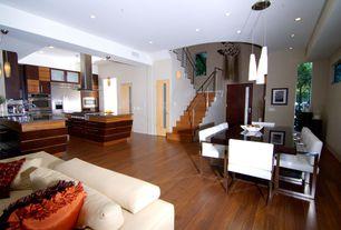 Contemporary Great Room with Built-in bookshelf, Pendant light, specialty door, Wall sconce, Chandelier, Hardwood floors