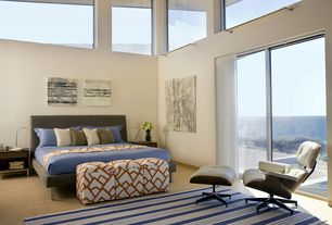 Contemporary Master Bedroom with picture window, High ceiling, Laminate floors, sliding glass door