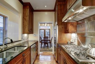 Craftsman Kitchen with Built In Refrigerator, Wall Hood, dishwasher, Stone Tile, full backsplash, double-hung window, Flush