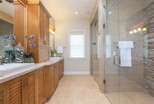 Modern Master Bathroom with wall-mounted above mirror bathroom light, drop-in sink, Flat panel cabinets, specialty window