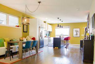 Eclectic Great Room with Built-in bookshelf, Pendant light, Hardwood floors