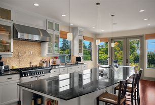 Traditional Kitchen with One-wall, Undermount sink, double oven range, Kitchen island, double-hung window, Breakfast bar