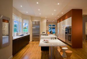 Contemporary Kitchen with Galley, Corian counters, Undermount sink, Breakfast bar, European Cabinets, Flush, Kitchen island