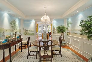 Traditional Dining Room with interior wallpaper, Chandelier, Chair rail, Crown molding, Hardwood floors