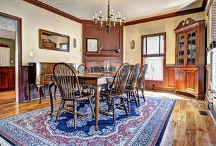 Country Dining Room with Built-in bookshelf, Standard height, Well Woven Barclay Medallion Kashan Navy Area Rug, Chandelier