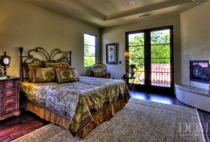 Mediterranean Master Bedroom with picture window, Cement fireplace, Built-in bookshelf, can lights, French doors, Fireplace
