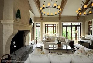 "Traditional Living Room with Cathedral ceiling, Restoration hardware pillar candle round chandelier 32"", Exposed beam"