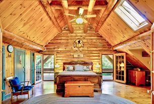 Rustic Master Bedroom with Built-in bookshelf, Exposed beam, Ceiling fan, flush light, Hardwood floors, Cathedral ceiling