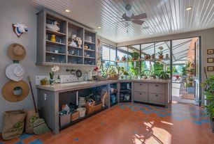 Country Mud Room with Built-in bookshelf, Glass panel door, Concrete tile , Ceiling fan