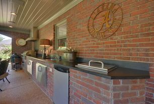 Traditional Porch with Outdoor kitchen, Fence, exterior tile floors