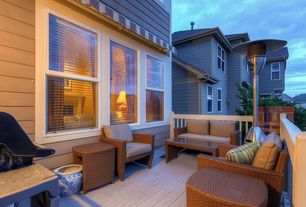 Modern Deck with exterior awning, double-hung window, picture window, Deck Railing