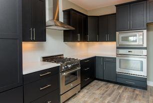 Modern Kitchen with European Cabinets, slate tile floors, Subway Tile, L-shaped, Cavaliere sv218b230 range hood, Flush