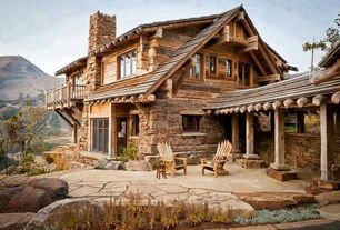 Rustic Patio with Adirondack chair, specialty window, exterior stone floors, Deck Railing