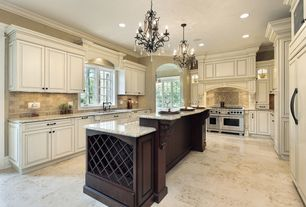 Country Kitchen with Standard height, Undermount sink, Built In Panel Ready Refrigerator, Wine storage, Limestone Tile, Paint