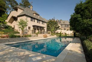 Traditional Swimming Pool with French doors, exterior stone floors, Raised beds, Lap pool, Pathway, Trellis