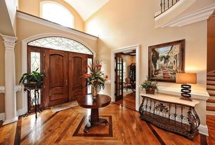 Traditional Entryway with Brakefield Pecan Round Table, Loft, Paint 1, High ceiling, Transom window, six panel door, Columns
