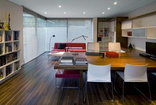 Contemporary Home Office with Hardwood floors, Built-in bookshelf