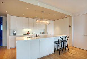Contemporary Kitchen with Corian counters, Kitchen island, Undermount sink, Breakfast bar, European Cabinets, L-shaped, Flush