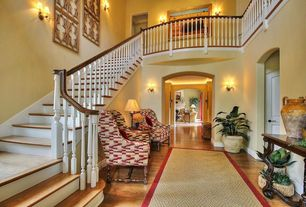 Traditional Staircase with Hardwood floors, High ceiling, Wing back eclectic chairs, Cutout screen wall decor, Paint