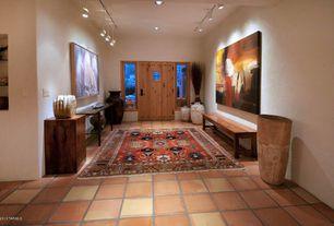 Eclectic Entryway with Glass panel door, Built-in bookshelf, terracotta tile floors, Pendant light
