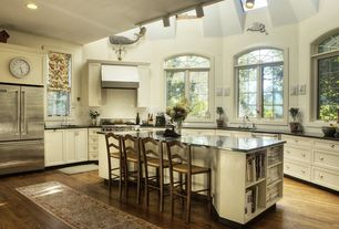 Traditional Kitchen with Flat panel cabinets, Soapstone counters, Breakfast bar, Skylight, Subway Tile, Kitchen island, Flush