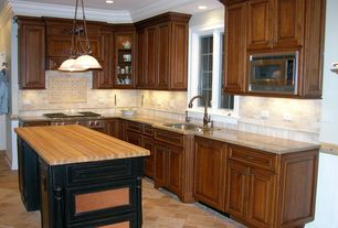 Traditional Kitchen with Crown molding, Kitchen island, Stone Tile, Pendant light, Limestone Tile, limestone tile floors