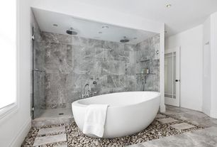 Contemporary Master Bathroom with Glass door, Stepping stones, frameless showerdoor, Handheld showerhead, Master bathroom