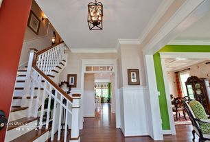 Craftsman Entryway with Crown molding, Chandelier, Hardwood floors, Wainscotting