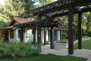 Mediterranean Landscape/Yard with Fence, exterior stone floors, Pathway, French doors, Raised beds, Arbor