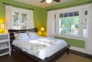 Cottage Master Bedroom with Ceiling fan, Standard height, Hardwood floors, picture window, Casement