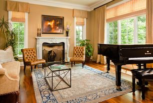 Traditional Living Room with Birch - Glazed Ginger 3 in. Engineered Hardwood Plank, Crown molding, Cement fireplace