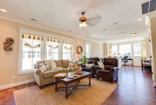 Traditional Living Room with Hardwood floors, Crown molding, can lights, flush light, Standard height, double-hung window