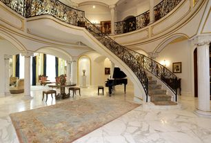 Mediterranean Entryway with simple marble floors, Crown molding, Balcony, Cathedral ceiling, Columns