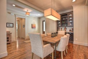 Contemporary Dining Room with can lights, Hardwood floors, Pendant light, flush light, Crown molding, High ceiling