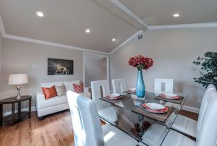 Traditional Dining Room with Crown molding, Standard height, Hardwood floors, Exposed beam, can lights