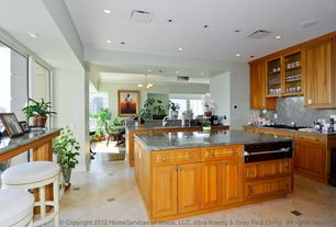 Craftsman Kitchen with Complex marble counters, can lights, limestone tile floors, L-shaped, Flush, warming oven, Glass panel