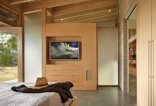 Contemporary Master Bedroom with Standard height, Transom window, specialty door, Concrete floors, picture window