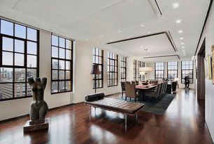 Contemporary Dining Room with can lights, Hardwood floors, double-hung window, Pendant light, Standard height
