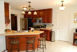 Traditional Kitchen with Multiple Sinks, stone tile floors, six panel door, Raised panel, Corian counters, gas range, Flush