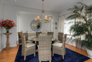 Tropical Dining Room with Chandelier, Laminate floors