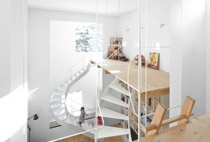 Contemporary Staircase with High ceiling, Built-in bookshelf, Hardwood floors, Spiral staircase