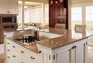 Traditional Kitchen with double wall oven, L-shaped, Paint 1, Inset cabinets, Standard height, Desert Brown Granite