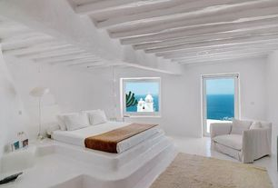 Mediterranean Master Bedroom with flush light, Concrete floors, Standard height, French doors, Casement, Exposed beam