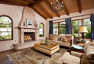 Mediterranean Living Room with KAS Oriental Cambridge Kashan I, World Imports Lighting Iron Works 8 Light Chandelier