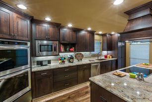 Craftsman Kitchen with Paint 1, Flat panel cabinets, European Cabinets, built-in microwave, dishwasher, Limestone Tile, Flush