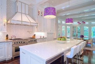 Contemporary Kitchen with French doors, Custom hood, Simple granite counters, Breakfast bar, Exposed beam, Glass panel